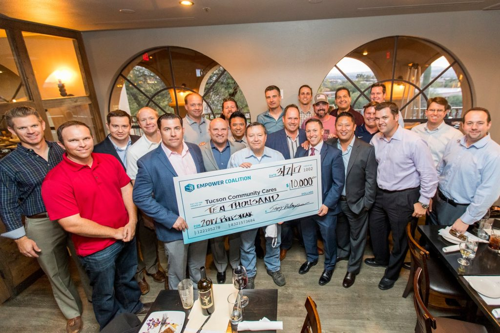 Members of Empower Coalition present Ben Buehler-Garcia of Tucson Community Cares Foundation with a check for $10,000 from the 2017 Tucson Beefsteak
